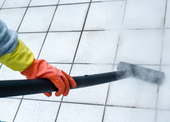 professional completing grout cleaning RI